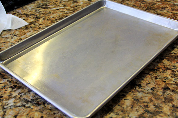 To ensure even cooking and no burnt bottoms, please use an aluminum baking sheet. If you use a coated baking sheet, there's a chance the bottoms will burn because those pans get hotter than they should.