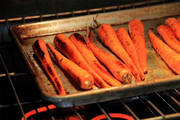 After about 10 min, turn the carrots over so they caramelize on the other side.