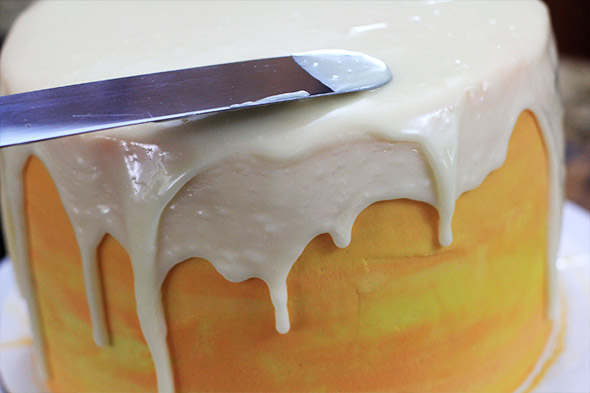 pour it on top of the cake and let it drip down the sides.