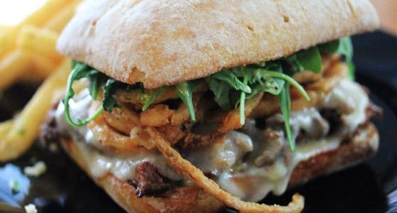 Steak & Cheese Sandwich with Crispy Onions and Arugula-Pesto Mayo