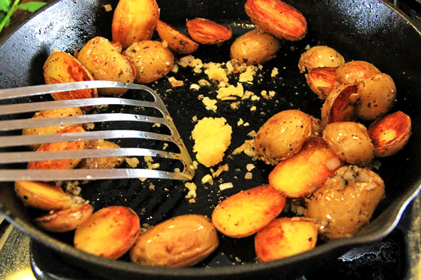 Add the garlic and cook for 1 minute. Toss the potatoes with the shallolts, garlic until evenly mixed. Taste and adjust seasoning if necessary.
