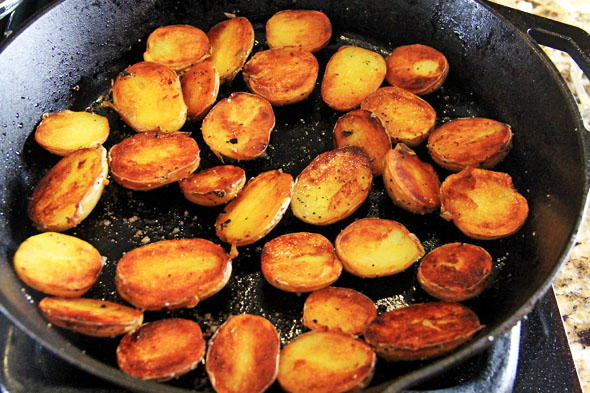 The potatoes are done when the oil is all soaked up and they're beautifully golden brown. Ahhh!