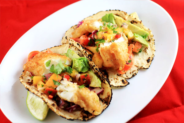 Crispy Tempura Fish Tacos with Peach'o de gallo and Chipotle-lime Slaw