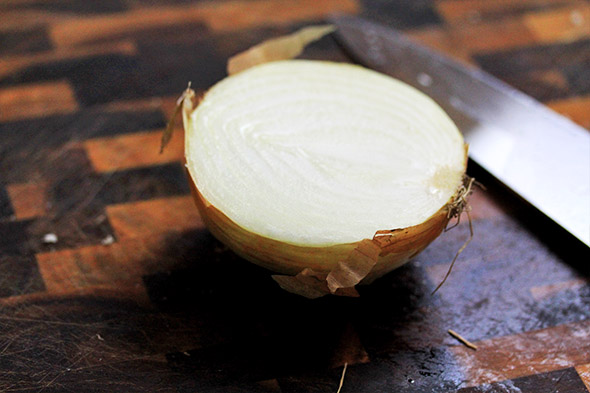 chop a large sweet onion in half, or use a small one. if using a large, wrap it up tightly with plastic and save for another use.