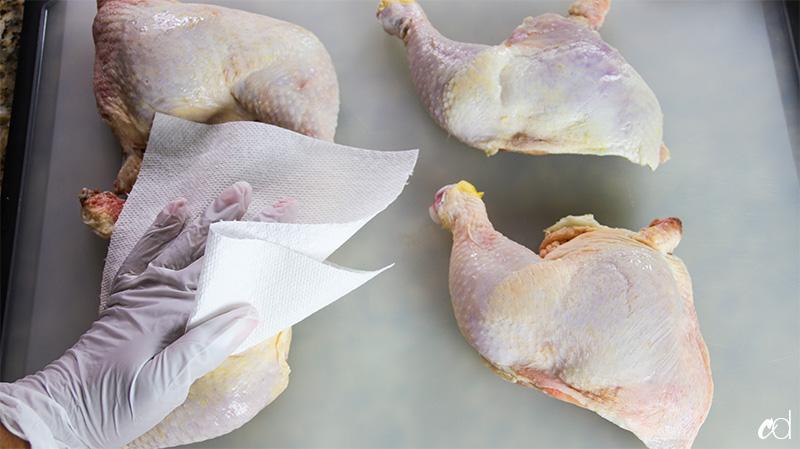 patting chicken skin dry