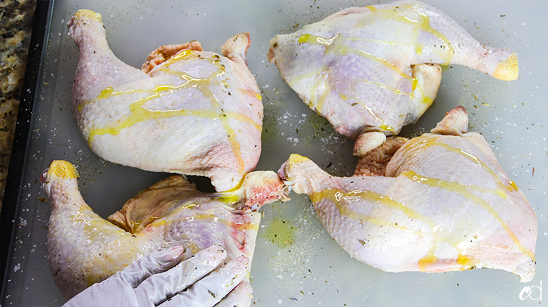 olive oil drizzled on raw chicken