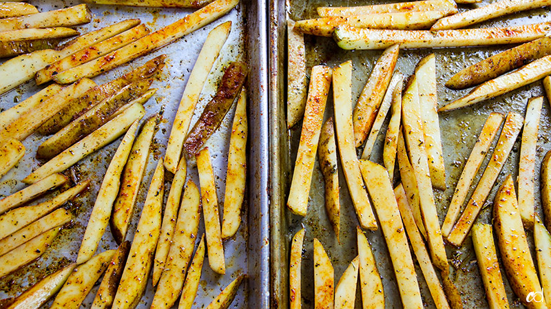 potato fries on baking sheet seasoned and oiled