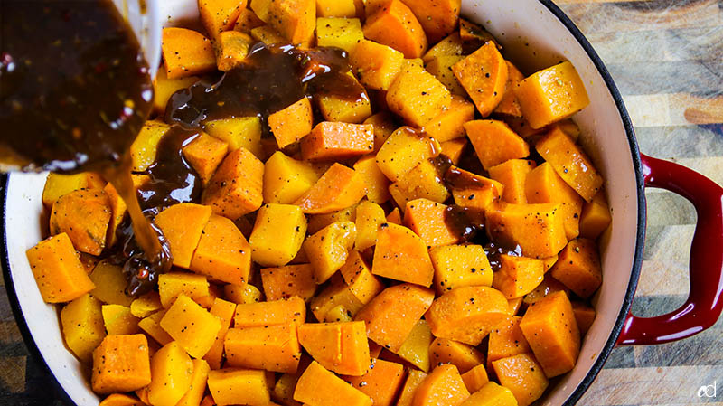 adding savory caramel to sweet potatoes and butternut squash