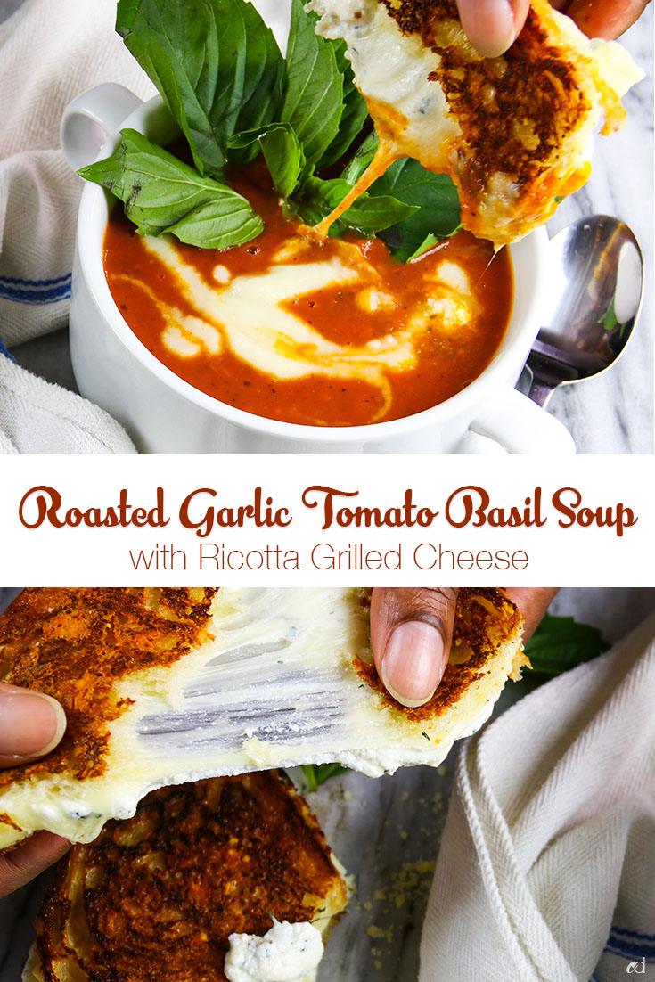Roasted organic tomatoes with garlic, shallots, and fresh basil pureed into a delicious vegetarian soup and dolloped with sweet onion cream. Served with a parmigiano crusted ricotta grilled cheese | #carnaldish #vegetariansoup #vegetariantomatosoup #tomatosoup #roastedtomatosoup #roastedtomatobasilsoup #soups #ricottagrilledcheese #grilledcheese